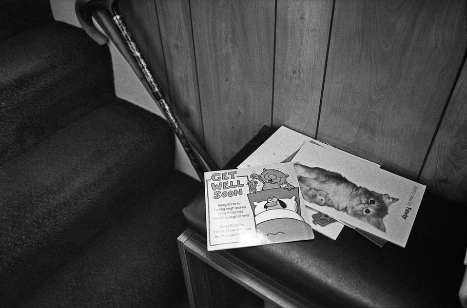 Some of Dennis' get well soon cards from his lengthy stay in hospital are left on a side table in the downstairs hallway.