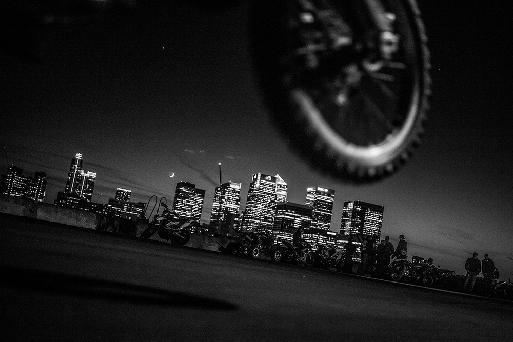 Justo pops a wheelie during a meetup at the 02 Strip in North  Greenwich, in front of the Canary Wharf Skyline London. 20/05/2015