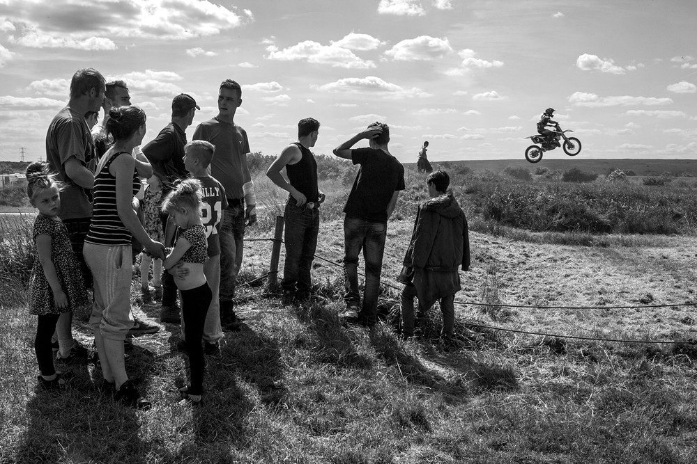 A family gathers to watch a Motocross practice session at Joyce Green MX. many riders in the London Bikelife scene take part in races and events here. 07/06/2015