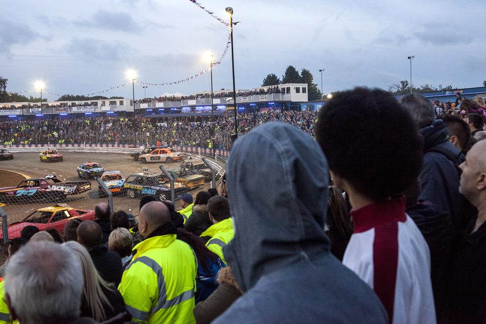 Spectators watch the final wildcard entry heat during the Spedeworth Unlimited National Bangers World Final event at Foxhall Stadium, Ipswich. Oct 2015.