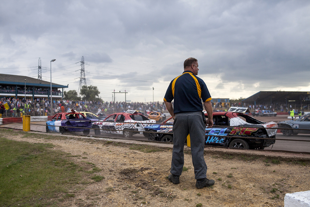 A race marshal oversees action at turn three during a destruction derby event at Arena Essex Raceway. 2014.