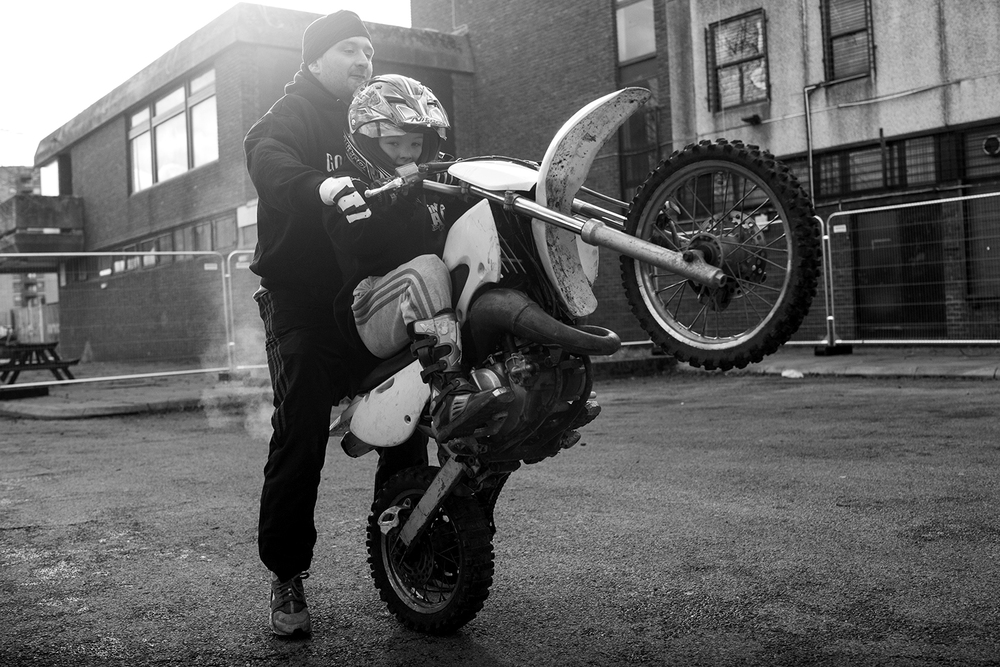 """It was very important for me to get involved in whatever sport Riley was involved in. It's important I get involved to share the bond with him for one, but to also push him in the right direction.""  Dogfather teaches his son Riley, aged 9, how to pop a wheelie"