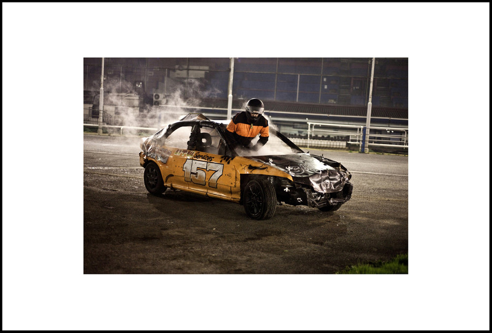 Driver 157, Dan Bramwell, Exits His Car After An Engine Malfunction During A Bangers Race Meet At Wimbledon Racetrack
