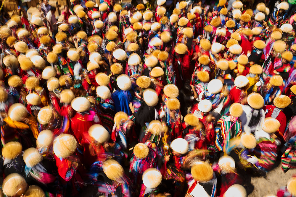 Crowds of Parachicos in colourful robes, masks and yellow Monterras (hats) make their way through the streets of Chiapa De Corzo during the Festival of San Antonio Abad. Part of Fiesta De Enero.