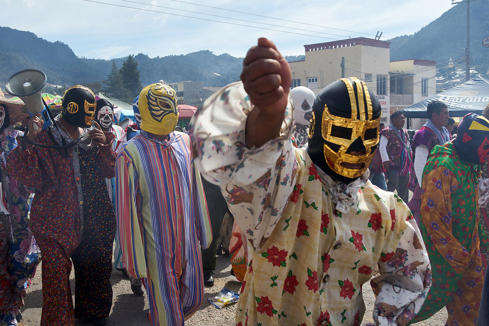 Tzotzil men from Zinacantan dressed up as a cross between a clown and a Luchador arrive in San Sebastian Plaza to perform the Torritos routine. a tradition widespread in different forms through out all of Mexico. In Chiapas the routine holds no ritualistic or religious meaning and is mostly just a form of entertainment for families and children.