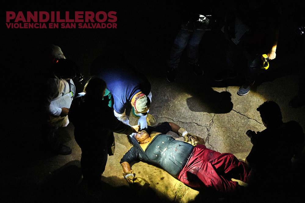 police investigate a murder scene after a female street vendor was shot over 20 times by MS13 members. witnesses said She had refused to give them money when they confronted her on a secluded pathway in    region, on the outskirts of San Salvador.