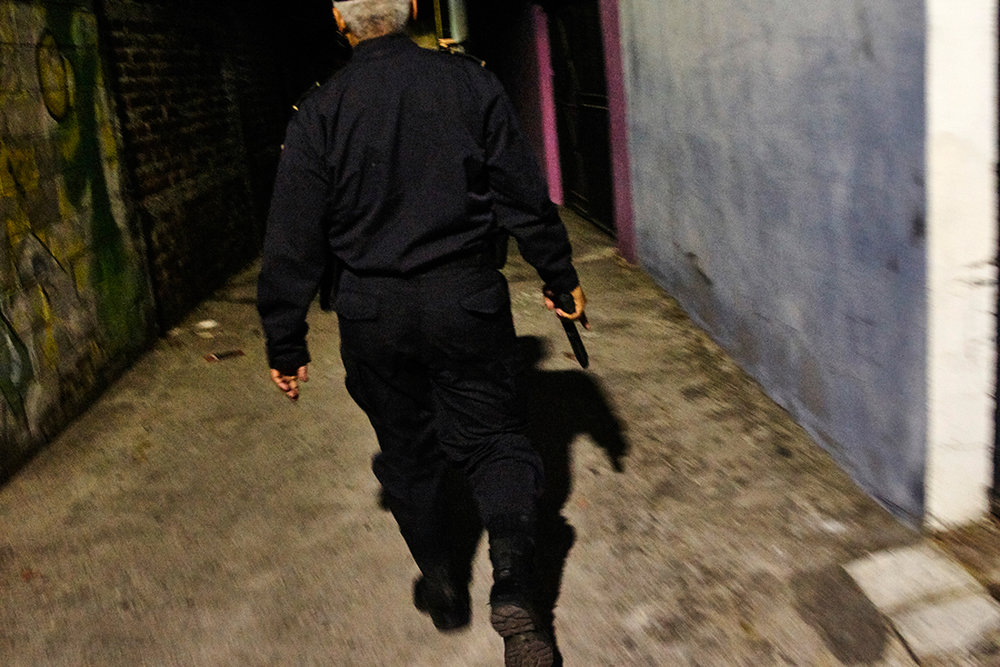 Cammandante Arevalo during a raid on suspected gang residencies in Central San Salvador.