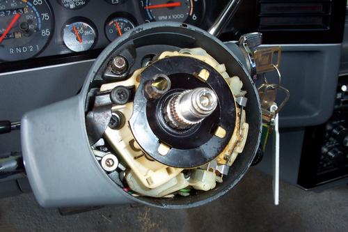 6.   Once you have removed the lock plate assembly, you may now remove the turn signal canceling cam and upper steering   column   shaft bearing spring.