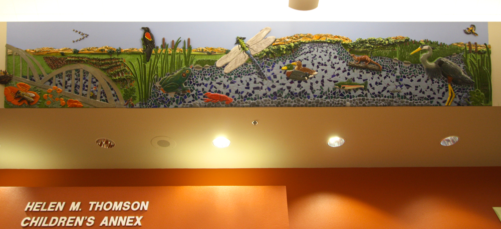 """Tour de Davis: Putah Creek""  3'4""x18' Ceramic relief and tile  Located in Children section of Davis Branch of Yolo County Library  2010"