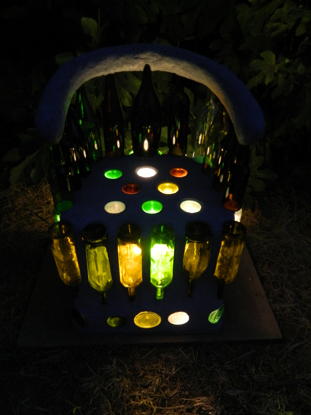 """Wine Seat (Illuminated)  Glass bottles and cement  34""""x24""""x20""""  2013"""
