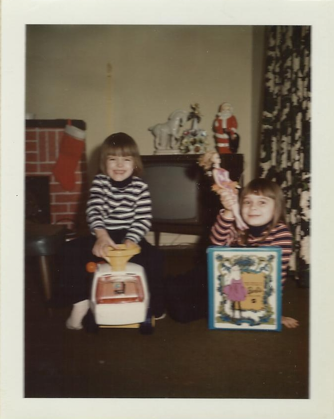 That's me with the Barbie doll and the cheesy grin…the other one is psychic.