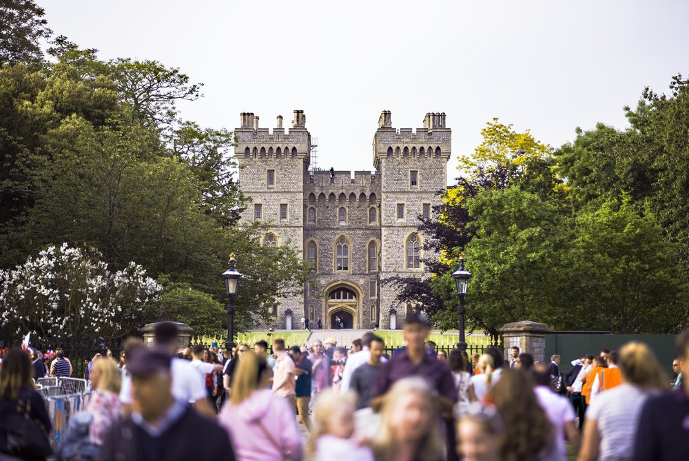Crowds converging on Windsor to celebrate the Royal Wedding of Prince Harry and Meghan Markle. Photo by  King's Church International  on  Unsplash