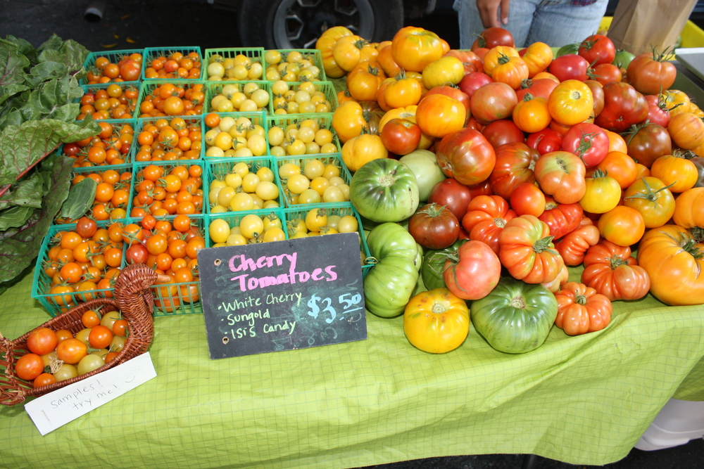 A variety of cherry and heirloom tomatoes being sold at the Veggielution Farmstand.