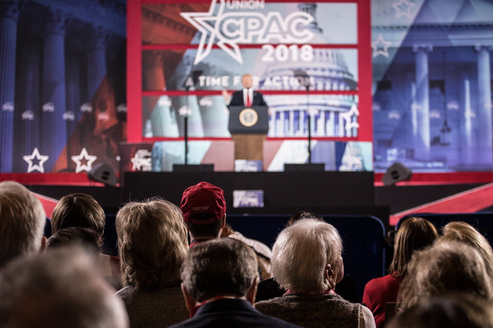 CPAC 2018 crowd watches President Donald Trump speak.