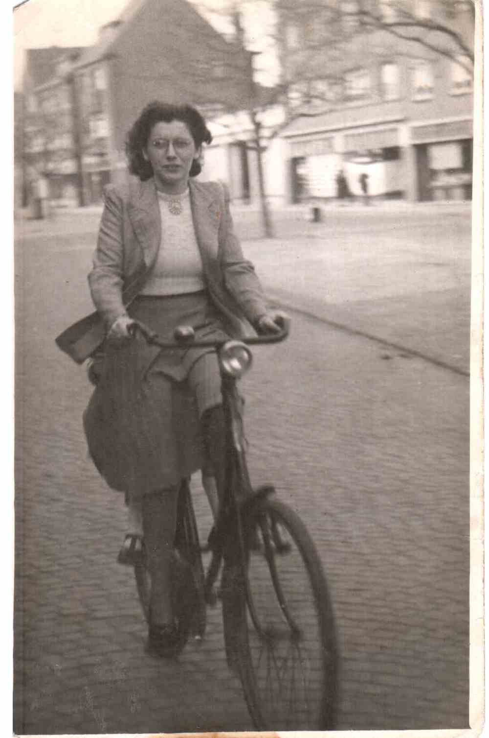 My beautiful grandmother on her bike in the Netherlands with my aunt riding with on the back.