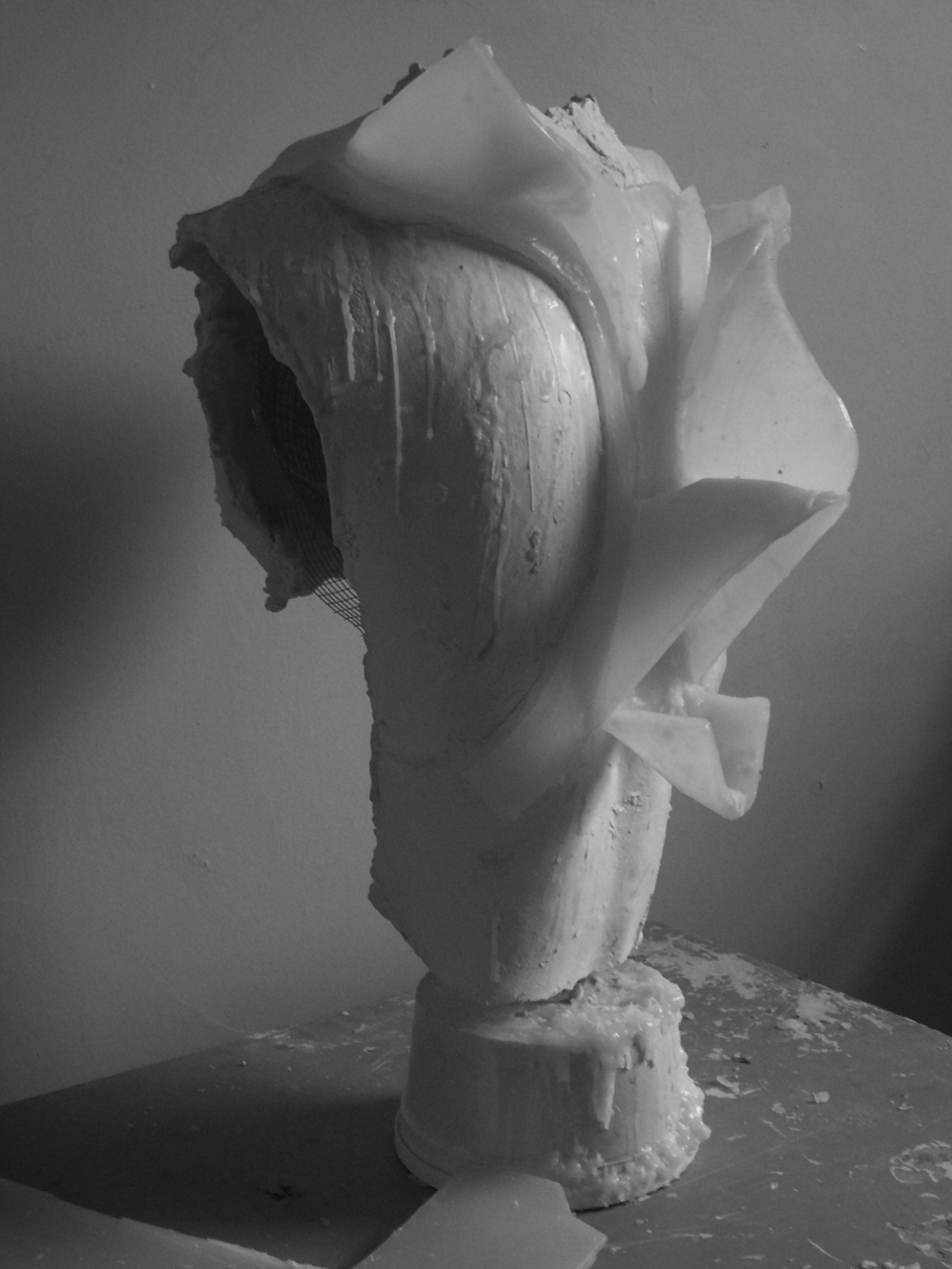 A Haunting, haunting apparatus, plaster, wax and wicking, 2007