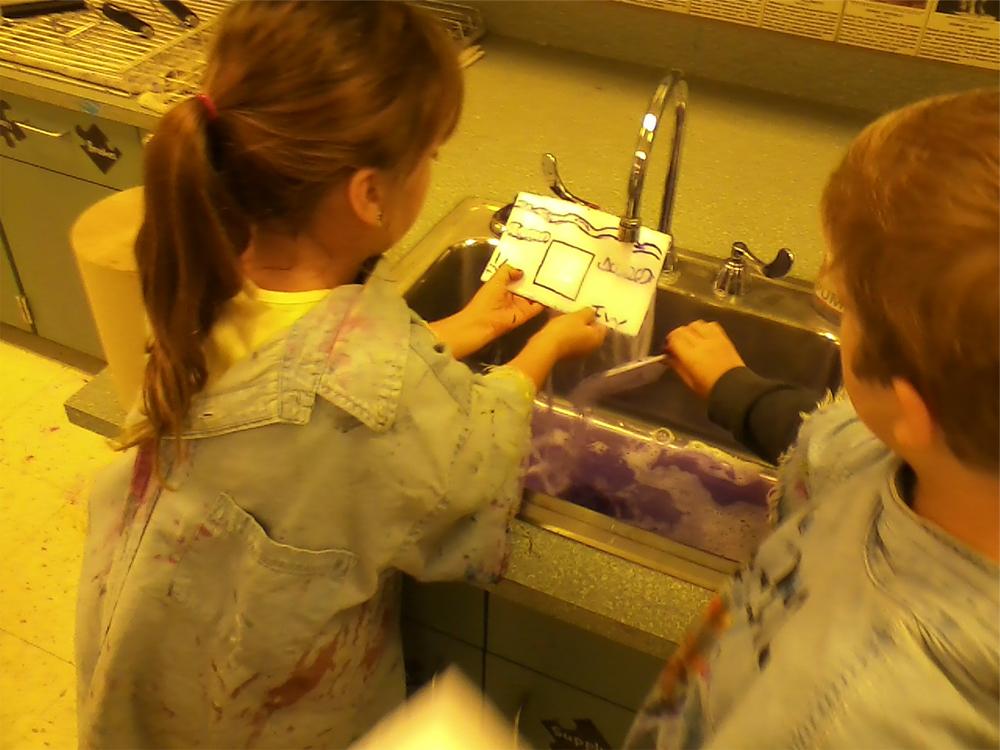 Student washing Plate.jpg