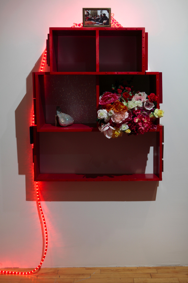 Wu Tsang and R. J. Messineo,  Approximate Alter (Life Chances) , 2011, Wood, spray paint, photos, frames, plastic flowers, Rhinestone clutch, 44 x 36 x 13 3/4 inches