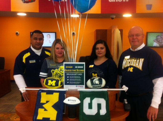 The Michigan First Credit Union team in Licoln Park getting ready for the big game!