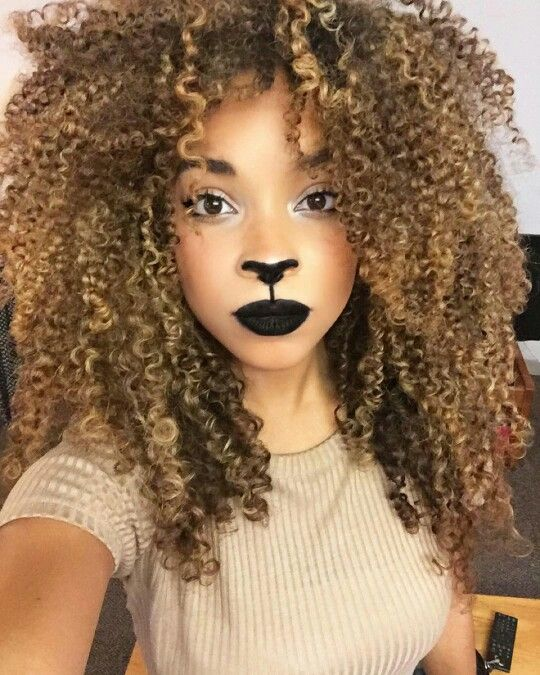 6. Lion - Get wild and crazy with this look! Tease your hair and add ears to create this ferocious look.