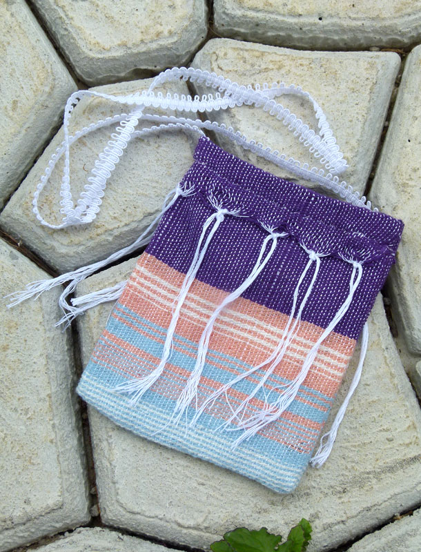 "This purse is going to my friend Rebekah who made the pretty purple blouse for me (see previous posts). She noticed this fabric hanging around and commented on the interesting color combination so I think she will enjoy this 7"" x 9"" bag that is lined in muslin and has fringe on both sides."