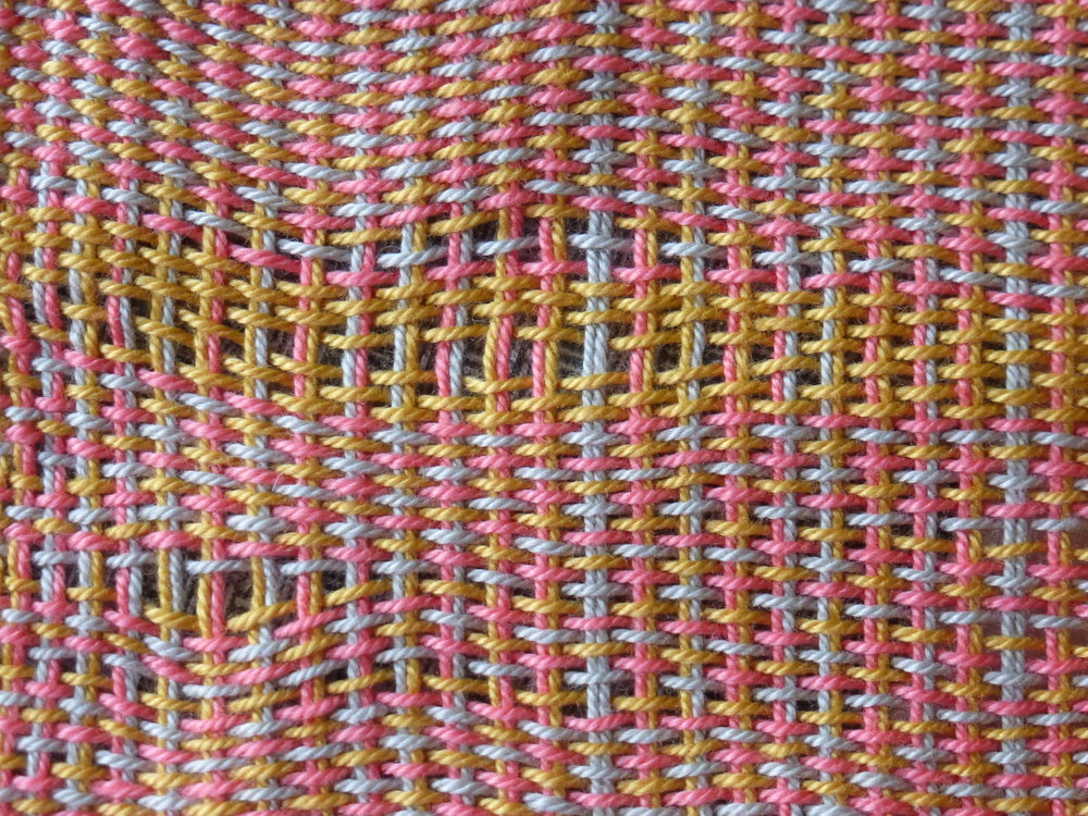 This shows the problem of the slippery warp. The fabric looked solid but as soon as you put pressure on the cloth, the threads slid around and created holes.