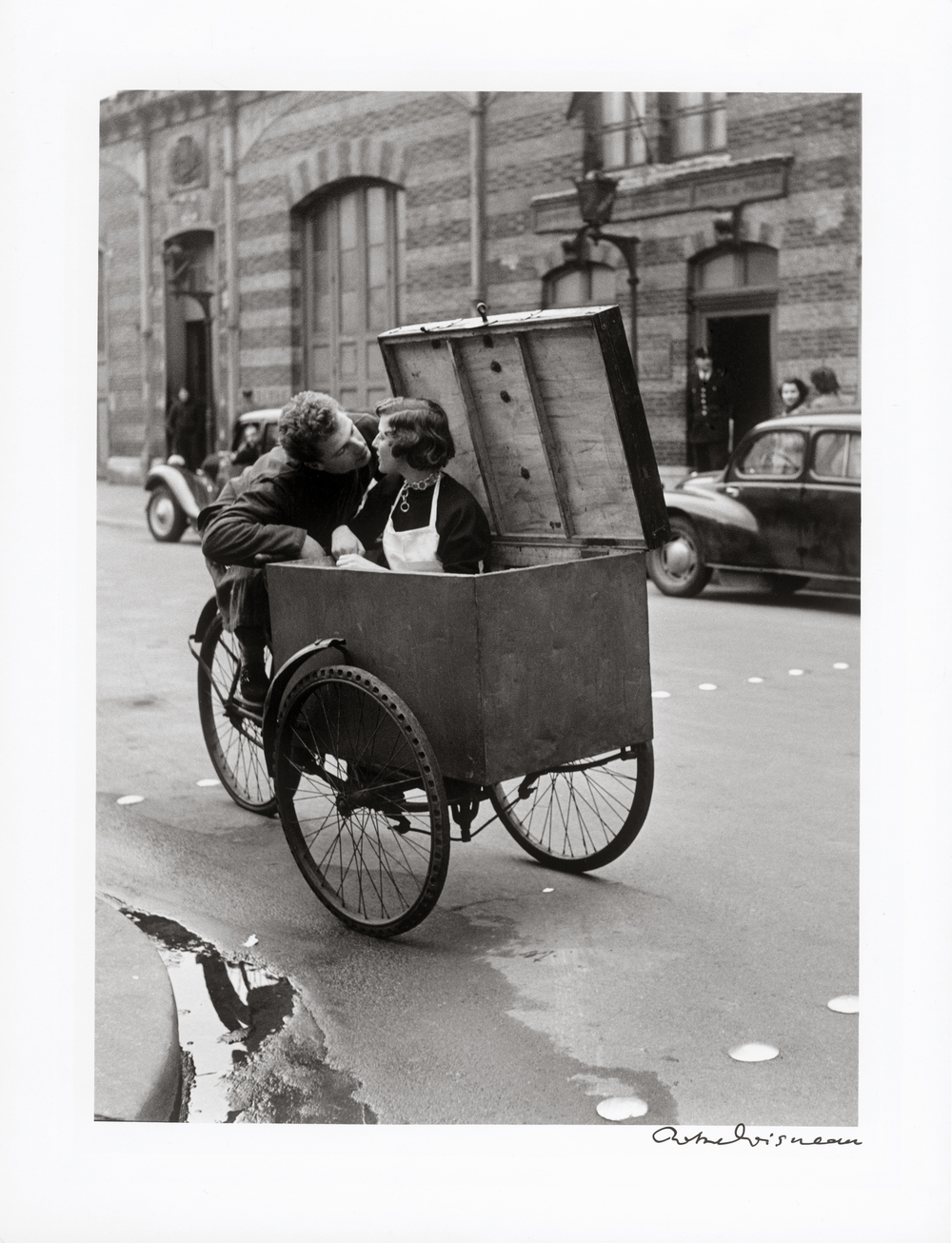 Robert Doisneau made this photograph in 1950 as a commission from Life Magazine to promote Paris as the city of Love. Love it is, as I loved Doisneau dearly and was with him on his 90th birthday in Oxford.UK. The print I have owned for 25+ years, it is much older than that ... having taken it to America during my 5 year stint @ Savannah GA College.    IT HAS BEEN A TOTAL INSPIRATION TO MY CAREER AS A PHOTOGRAPHER/PROFESSOR.    This fine art print is signed, by Robert Doisneau on bottom right.THE PRINT is framed in a Hand Made frame with archival materials :: offered @ £7500