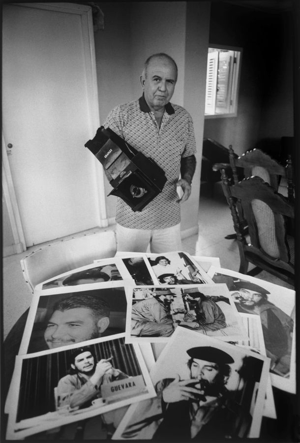 Perfecto Romero with his Photographs of Che and Fidel. Cuba. Photo : Keith Cardwell
