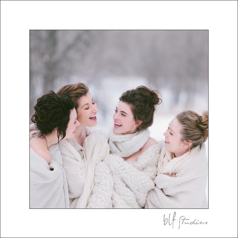 bride and bridesmaids having fun in the snow.jpg