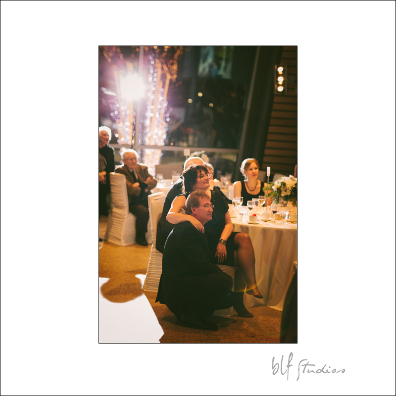 grooms parents viewing wedding slide show.jpg