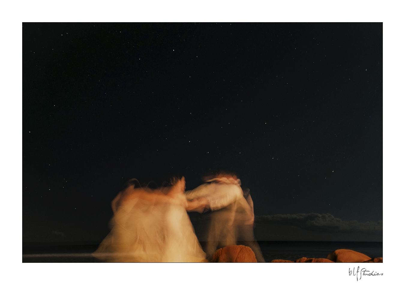 Dancing as husband and wife under the stars in Hawaii
