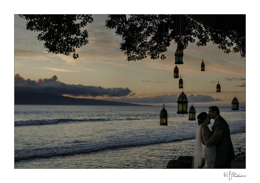 Sunset wedding reception under the trees at Olowalu Plantation House