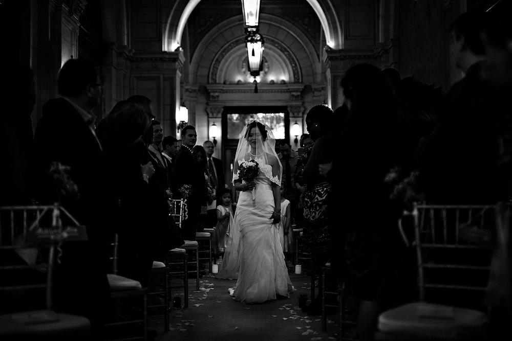 Bride walking down aisle in Hotel Fort Garry Winnipeg.jpg