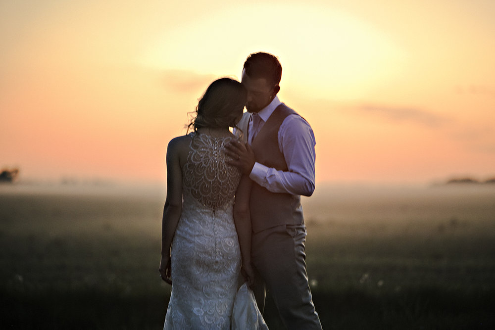 Sunset portrait of Winnipeg wedding couple