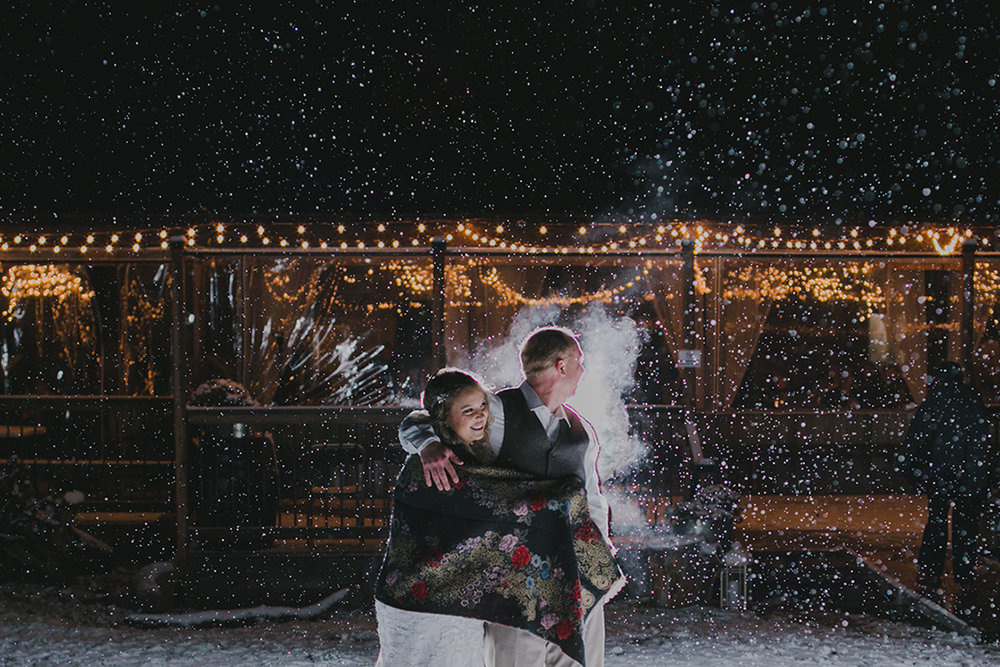 Night portraits in the snow at  La Lune Wedding Venue