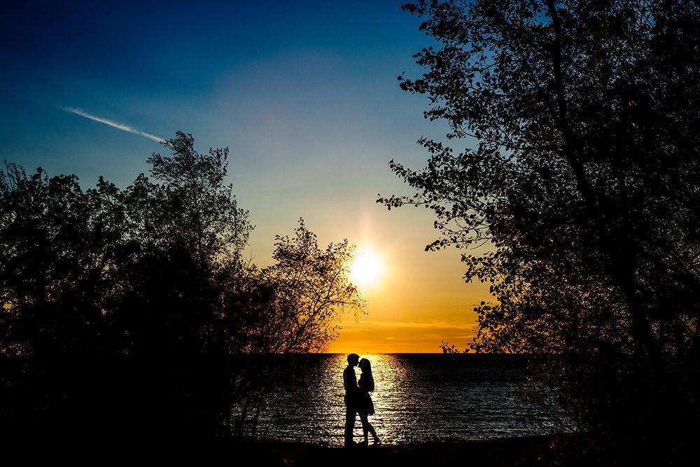 Beautiful sunset engagement photo at Lake Winnipeg by Tony