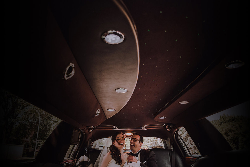 Bride and Groom in Limo after wedding in Winnipeg