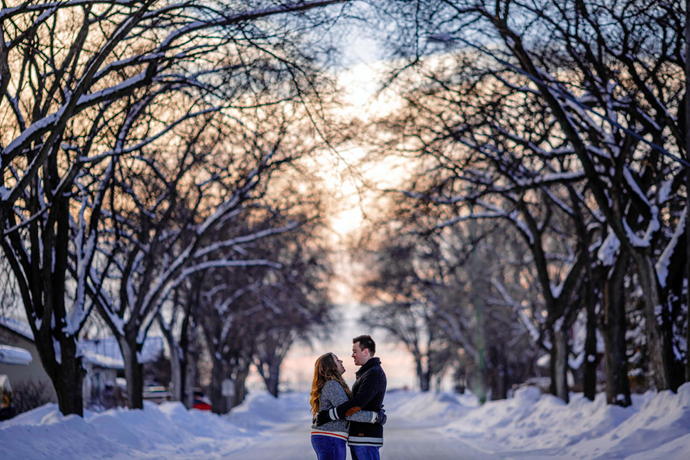 Couple by trees Winter engagement photo