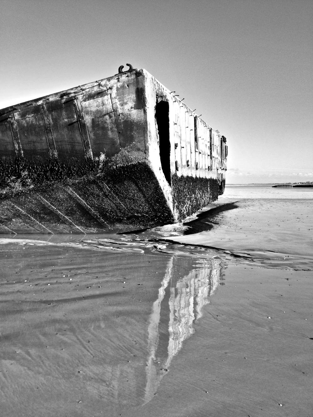 remnants of WWII on the beach at Arromanches les Bains