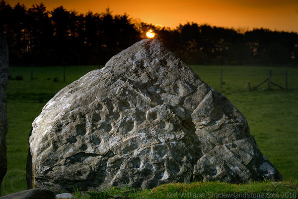 Sunrise at Bealtaine by Irish Photographer:  Ken Williams  At the Beltany Stone Circle in the North West of Ireland, the sunrise at Beltane is aligned with the only decorated stone in the circle. The Beltany Stone Circle gets its name from Beltane which is associated with the lighting of hilltop fires in a rekindling of the sun.