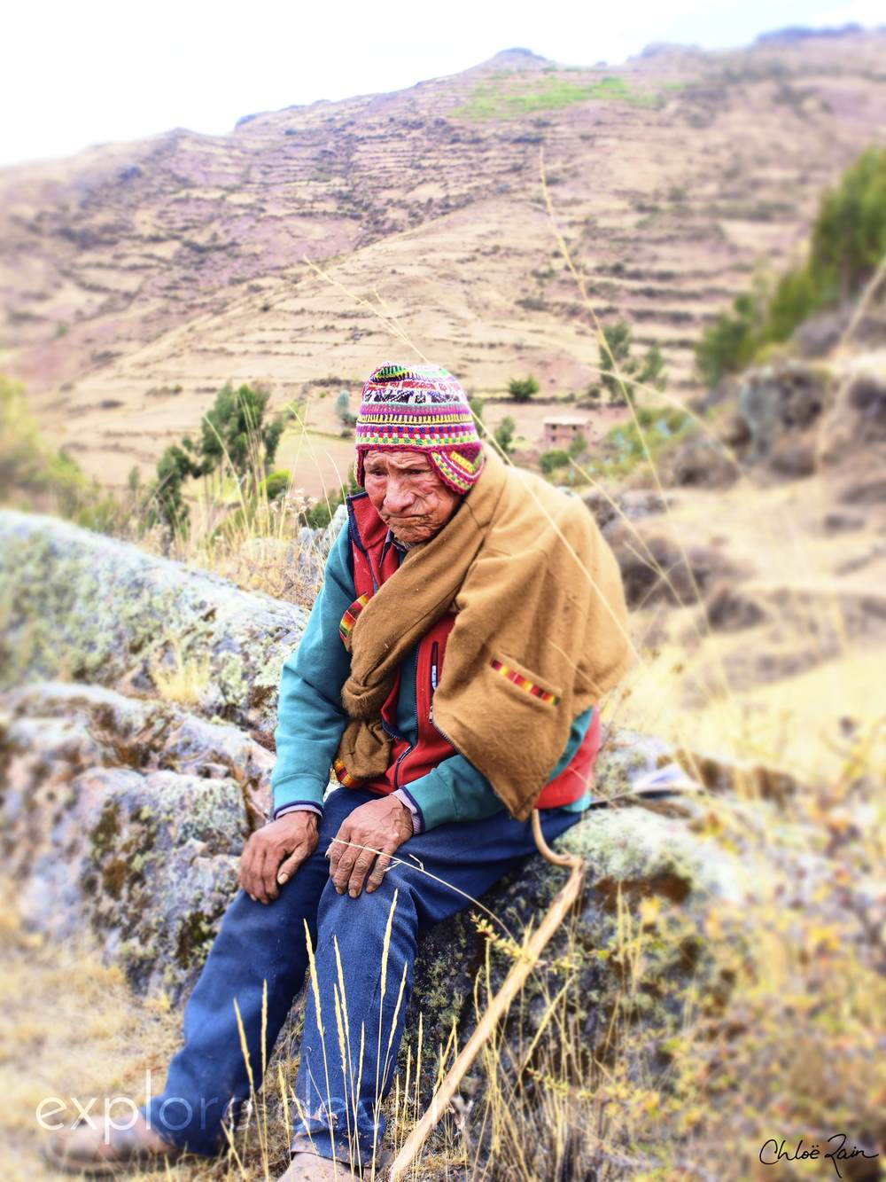 """Maestro Jesus, 80 year old Atamesayok Shaman, from Amaru. He was """"called"""" to his work by being struck by lightening 3 times in his youth. He does healing ceremonies for people from all over the world, and brought us to the mountaintop where he burns the offerings for their prayers."""