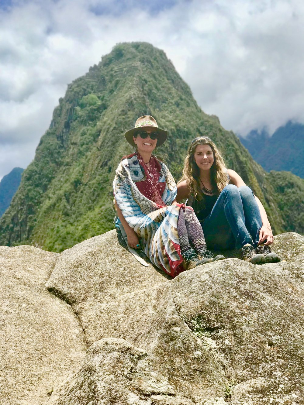 Chloë Rain, Spiritual Guide & Founder of Explore Deeply with  Walking the Path of Purpose Apprentice  on Machu Picchu Mountain with Huayna Picchu Mountain in the background.