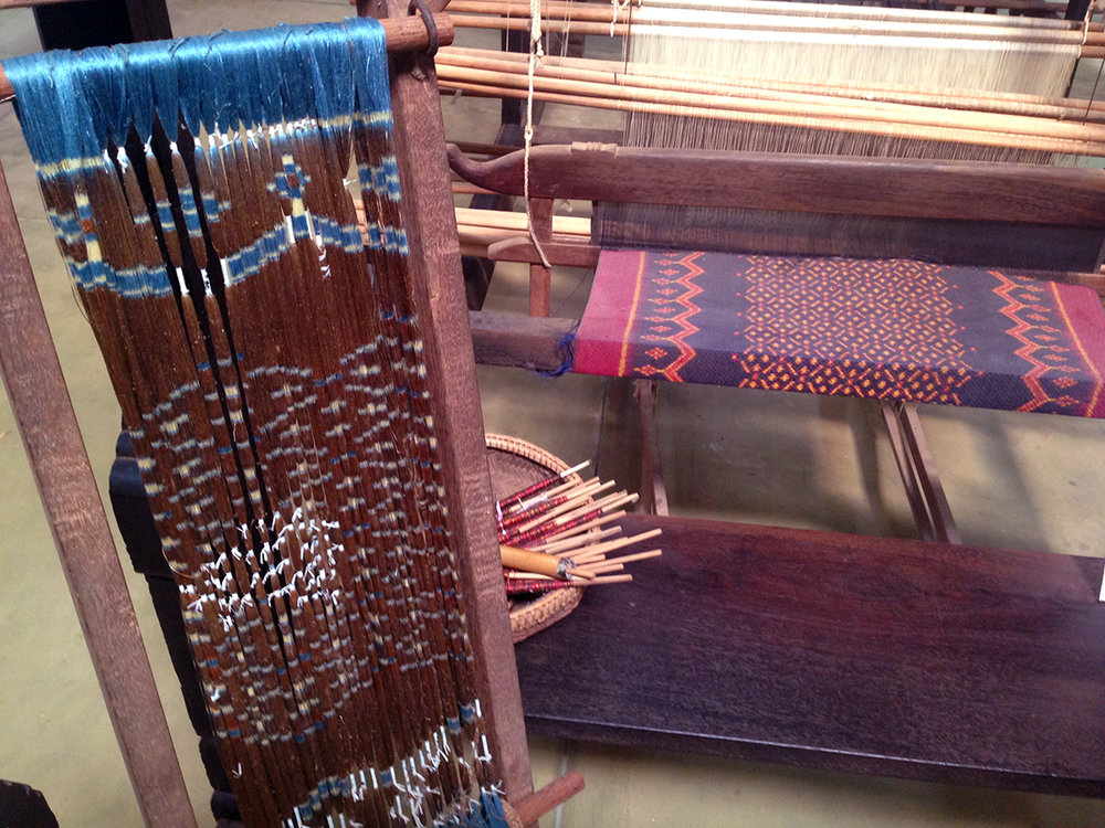 Silk Farm in Cambodia.  The weft is tie dyed before weaving so alignment is crucial.
