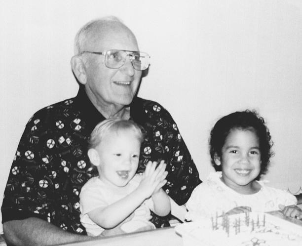 Grandpa Heyl, my little sister and I on his birthday.