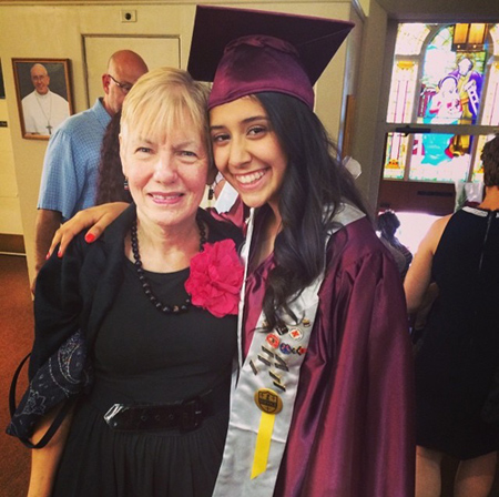Genesis at her 8th grade graduation with Ms. Buckley, former principal of Bridgeport Catholic Academy.