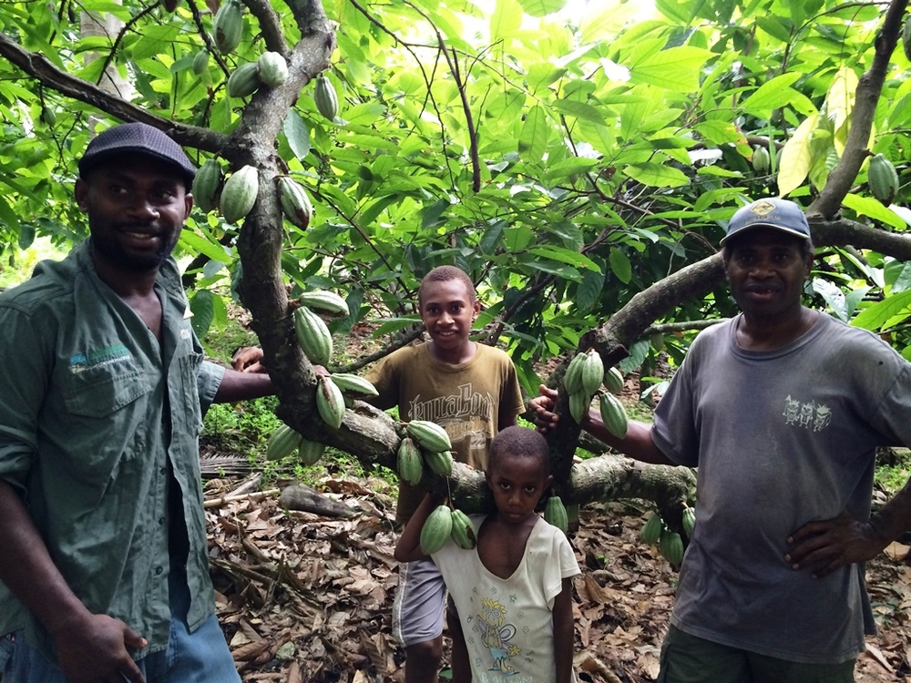 Cocoa grower Aisen Samuel (right) with his sons..