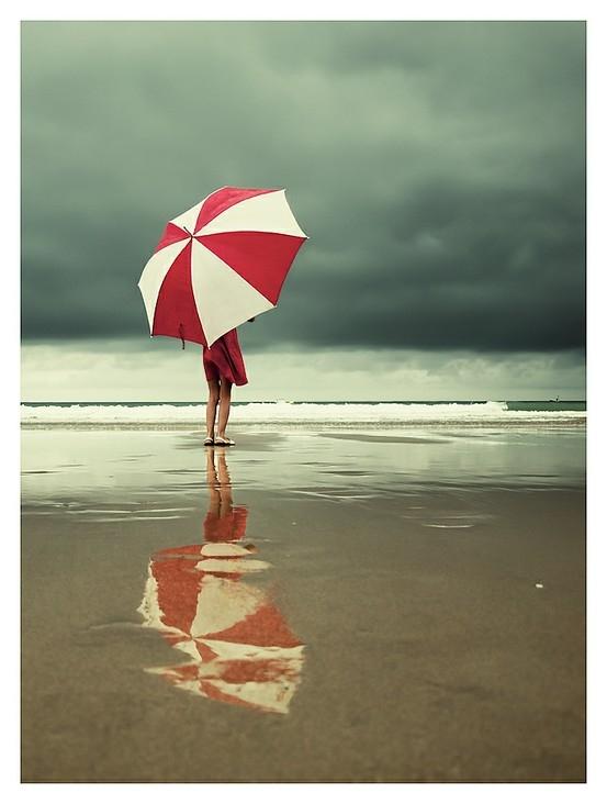 girl on beach with umbrella.jpg