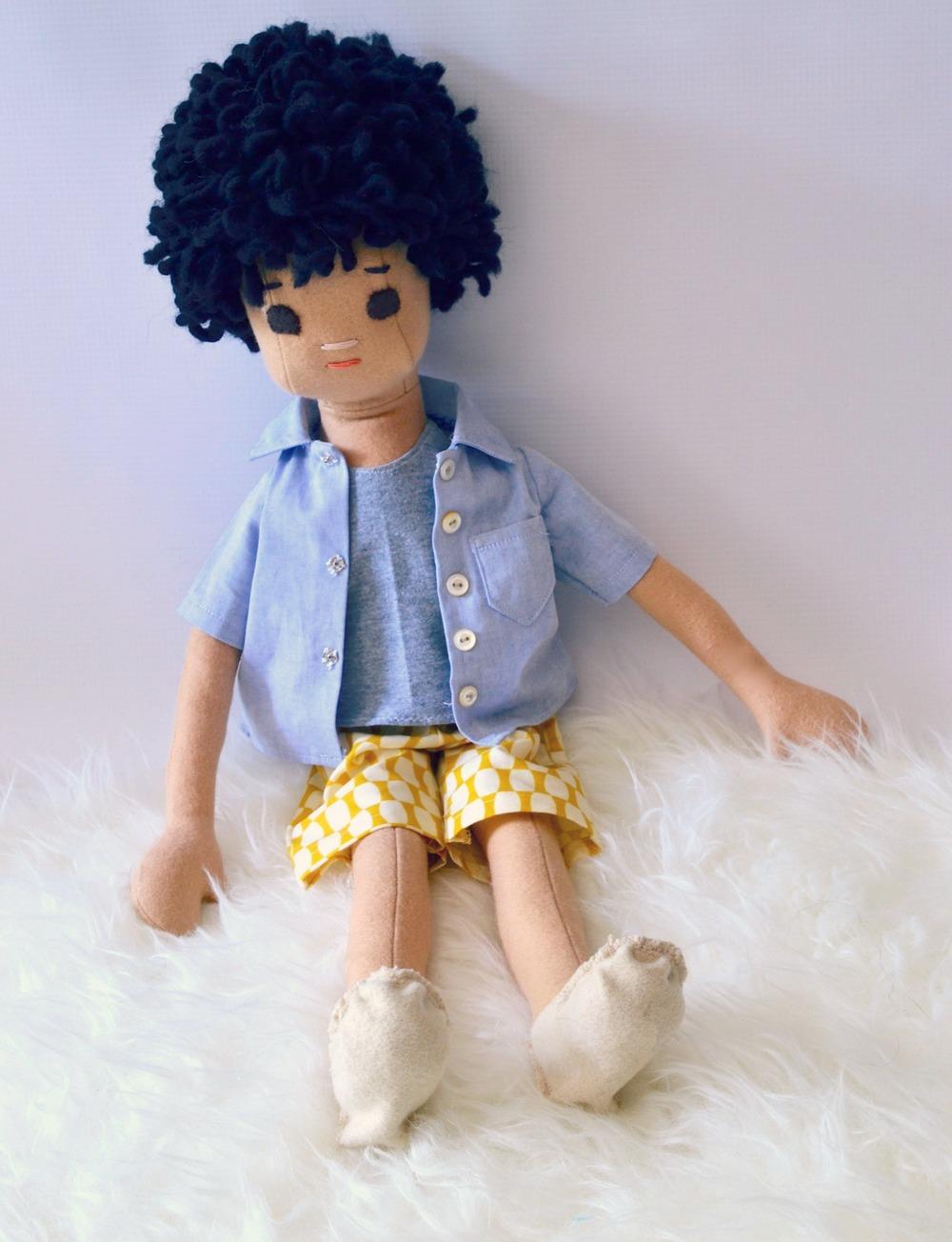 Black curly hair boy sitting1smaller.jpg