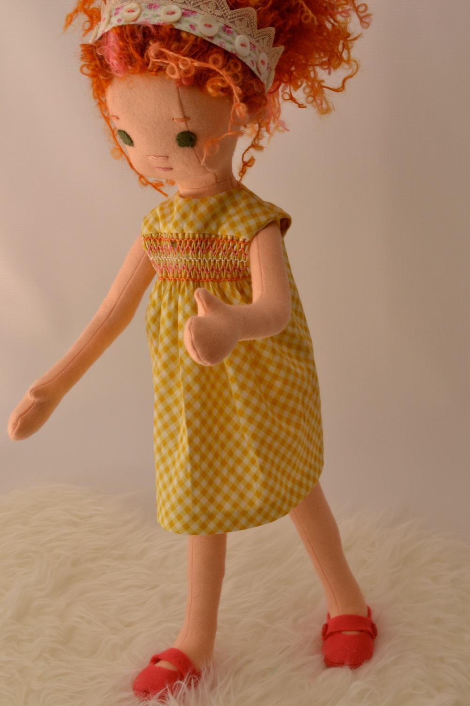 Fancy Nancy models a smocked dress.