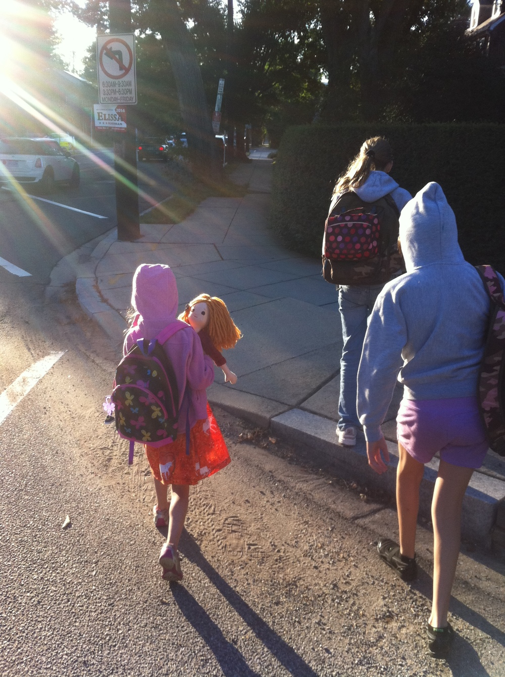 Phoebe and Gemma are off to school with matching dresses.